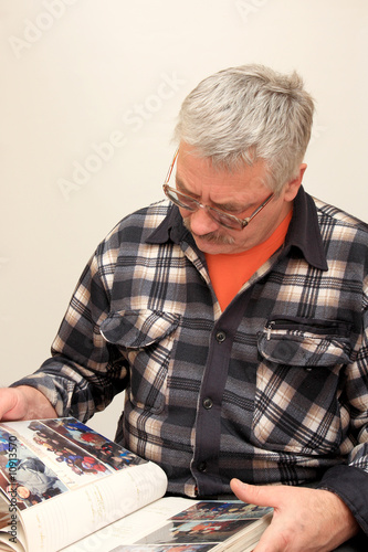 A man looks over pictures.