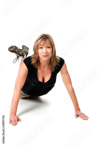 middle aged female doing push ups