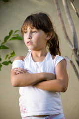 little girl with crossed arms looking side