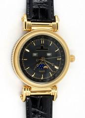 Goldene Uhr mit schwarzem Zifferblatt