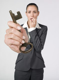 anxious businesswoman holding key of success poster