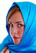 young girl wrapped in a blue scarf