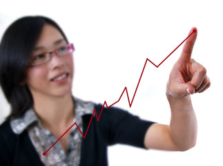 Female pointing to red trend line on white