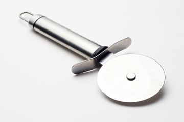 shiny metal pizza cutter isolated