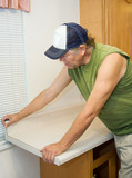 Contractor Working with Laminate poster