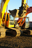 Hydraulic excavators at work. Shovel bucket against blue sky poster