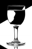 domino wine glasses in backlight on the black and white contrast poster