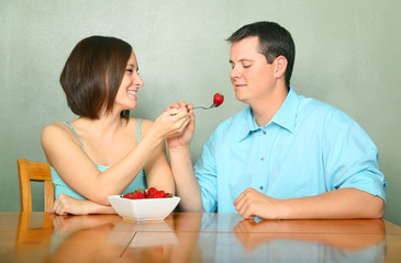 Romantic Couple Eating Fruits On Kitchen Table