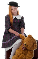 Redhead girl with toy and trunk bear is upset