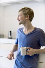 young man with a cup of coffee