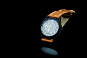 Classic Watch on a black background with a reflection
