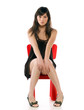 Girl on a toy chair