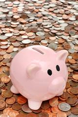 Piggy bank closeup over coins