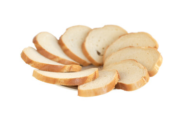 Plate of slices of a white loaf on a white background