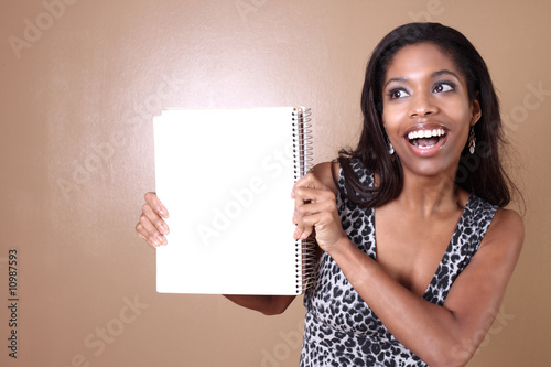 Woman holding a blank notebook
