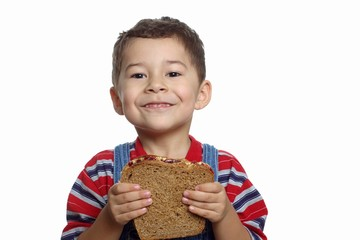 five-year-old boy with peanut butter and jelly sandwich