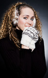 beautiful blond in headphones and mittens poster