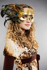 beautiful blond in venetian mask with feathers