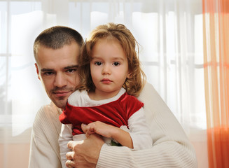 Daddy with the daughter at home