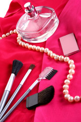 cosmetics on red background