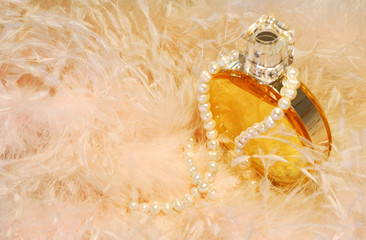 Feathers, necklace and perfume