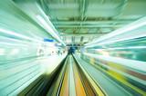 Fototapety Speedy trains passing train station. Focus on the rail road.