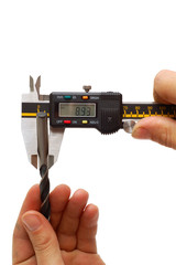 Worker measures diameter of auger with electronic caliper