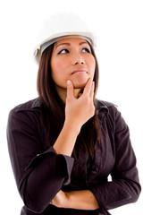 female architect thinking and wearing hardhat