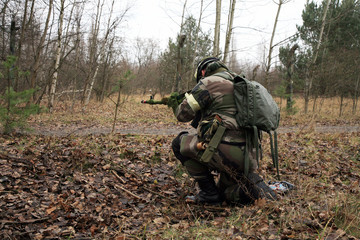 Soldier in camouflage - action