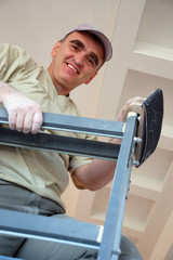 Smiling plasterer on ladder