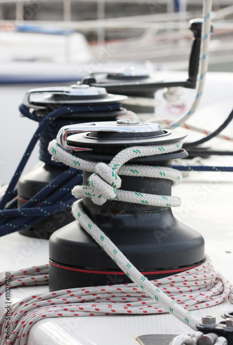 Winches with ropes on a sailing boat.