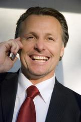 happy businessman on cellphone
