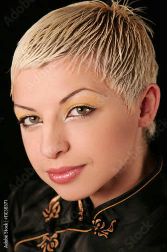 Portrait of young blonde with creative make-up