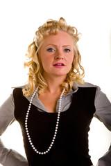 Curly Blonde in Pearls Looking Defiant