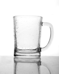 Empty beer mug with drops