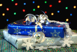 Christmas Gifts in front of Bokeh Lights poster