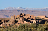Casbah ruin with Atlas mountains in background, Morocco poster