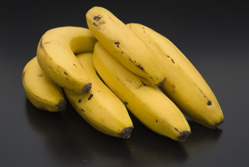 Bananas on black table