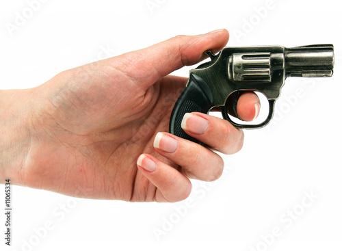Small revolver gun in female hand