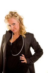 Curly Blonde in Black Blouse and Pearls Hand on Hip