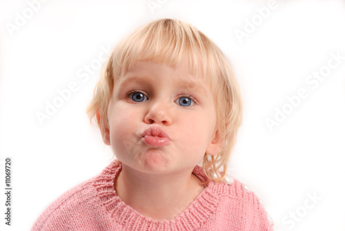 Little girl in pink knittet sweater moving to kiss