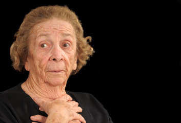 Elderly woman with a look of apprehension