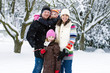 Happy family during winter in the snow