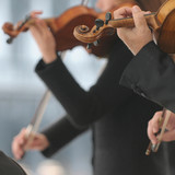 Violin players during an outdoor exhibition poster