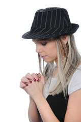 Girl with hat praying