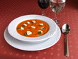 Dish of Italian cuisine -   sweet pepper soup on red tablecloth