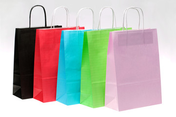 Five paper shopping bags at an angle