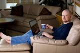 Man on Laptop in Pajamas poster