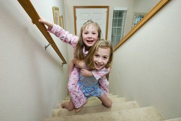 young kids playing on stairs