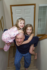 Dad carrying kids up stairs